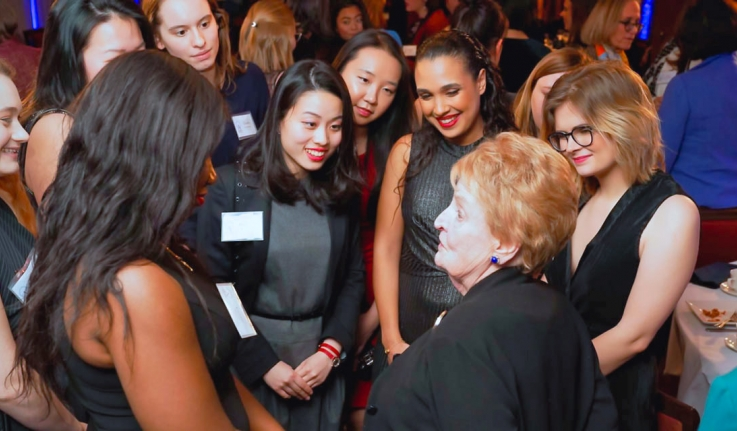 Madeleine K. Albright talking with students at an Albright Institute event.