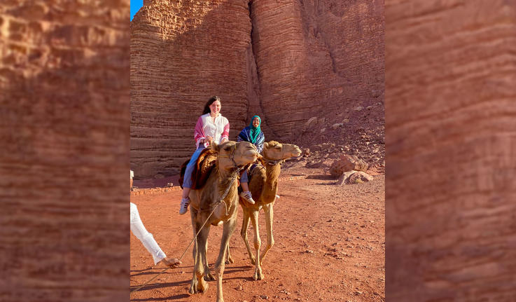 collage of students on camels in the desert of Jordan
