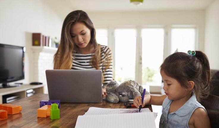 mom working from home with young child