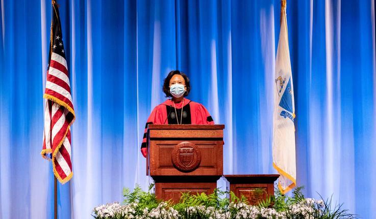 Paula Johnson speaking at podium