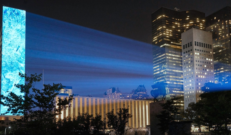 A photo of the UN building with light rays reflecting off it