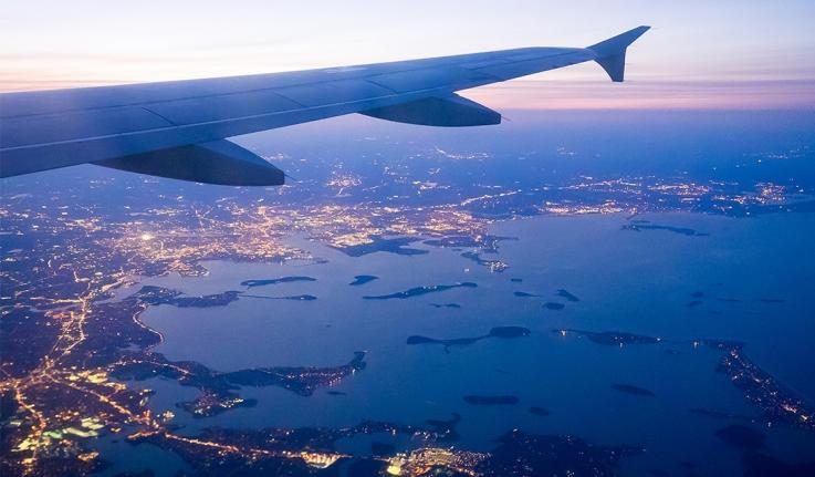 An airplane preparing to land over Boston's Logan airport