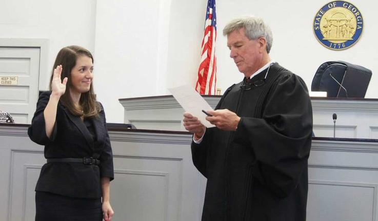 Alex Joseph '10 being sworn in as a prosecutor