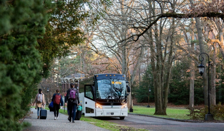 Students walk to a bus outside the chapel, bound for Boston.
