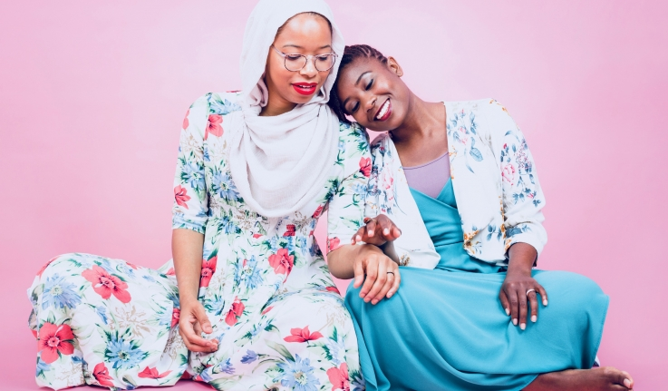 Wellesley Alumnae Makkah Ali '10 and Ikhlas Saleem '11 lean on each other.