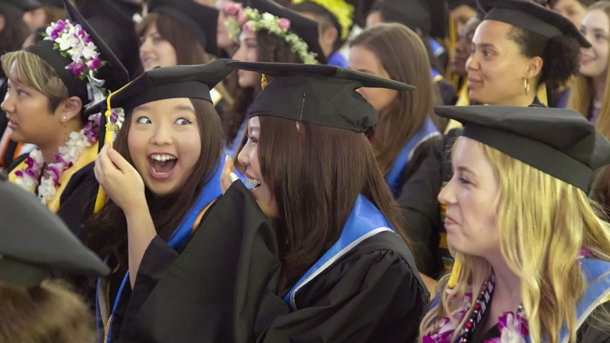 Two students react to the class of 2019 student speakers remarks.