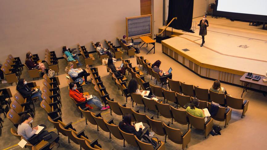 jennifer chudy teaches in auditorium