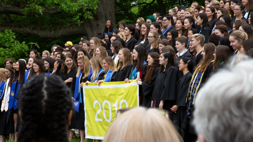 The Class of 2019 lines up for a photo on severance green.