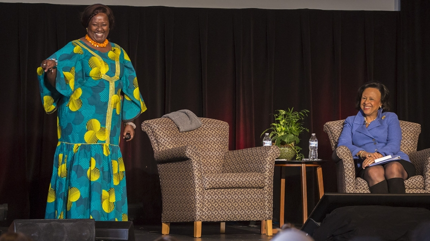Wellesley College President Paula A. Johnson listens to Agnes Binagwaho on stage at the African Women's Leadership Conference