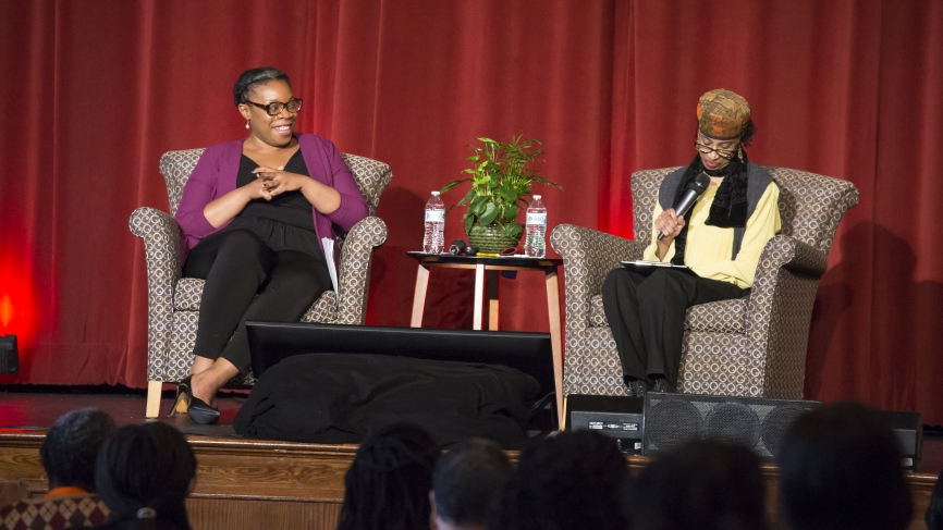 Mfoniso Udofia '06 and Lois P. Roach speak on stage.