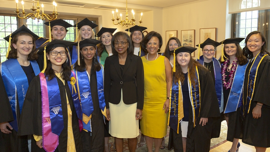 Students pose with Anita Hill and President Johnson before the ceremony
