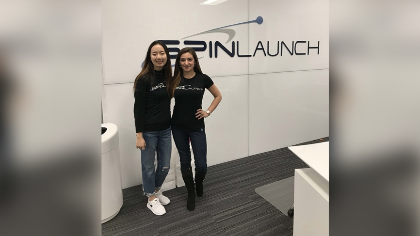 "Two women stand in front of branding that says ""SpinLaunch."""