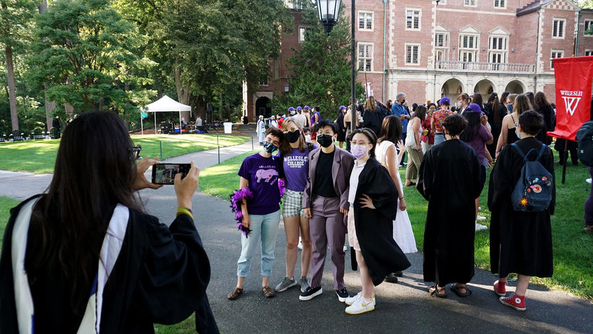 people pose for photos outside of convocation