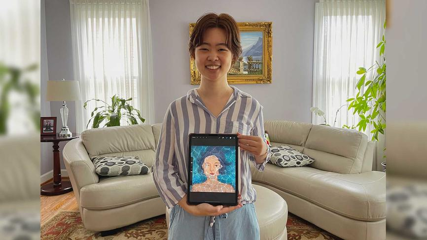 Jenn Duan '21 holds a digital portrait she created. The piece is meant to symbolize a mix of emotions, ranging from emotional tu