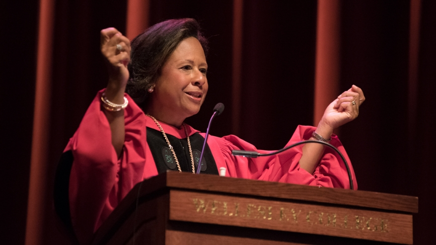 President Paula A. Johnson gives her opening remarks from the podium in Alumnae Auditorium.