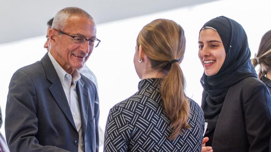 John Podesta speaks to two Albright Fellows.