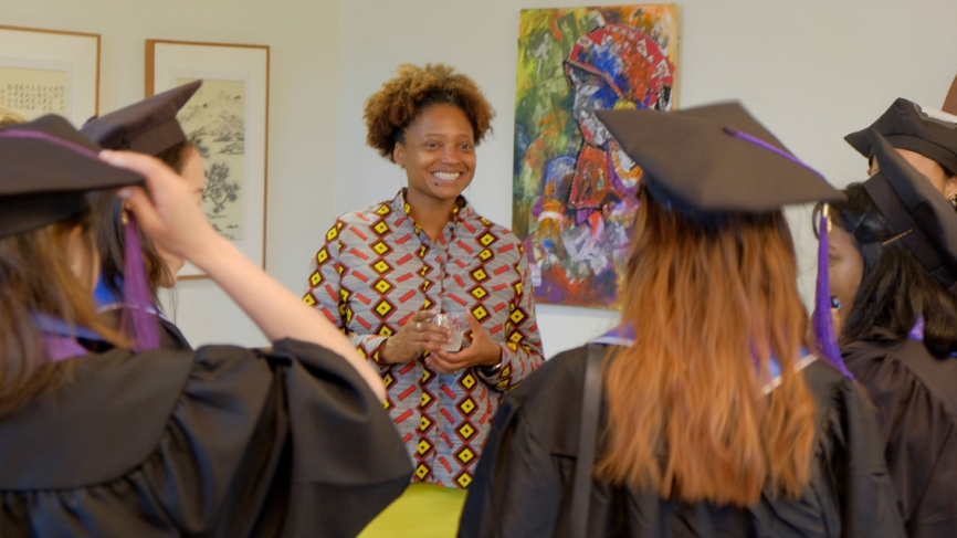 Wellesley commencement speaker Tracy K. Smith gathers with students to robe for the procession.