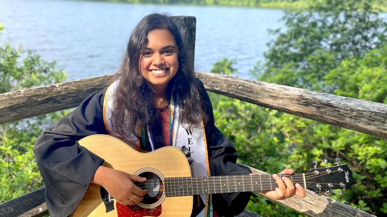 Kimaya Lecamwasam '21 holding a guitar