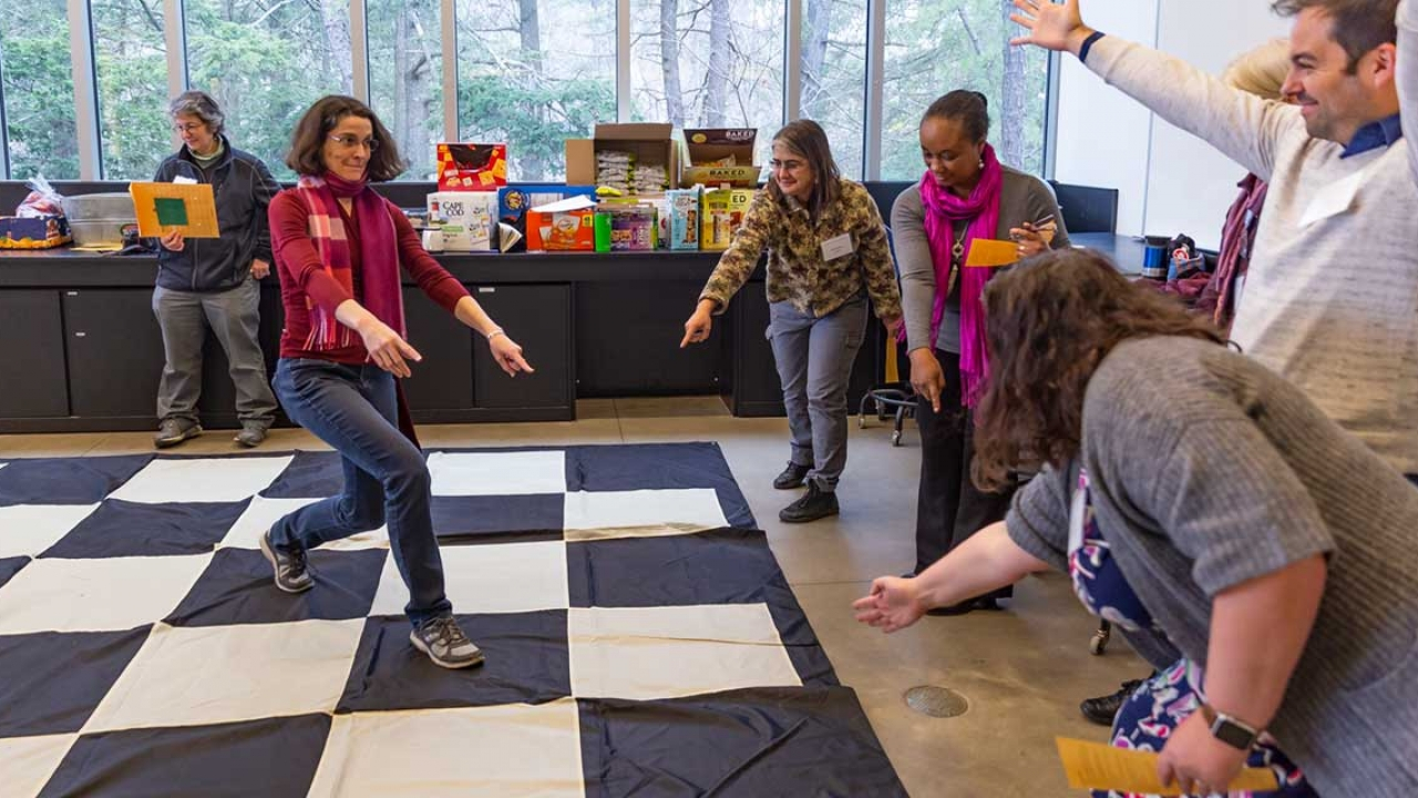 Faculty members participate in an activity during a retreat.