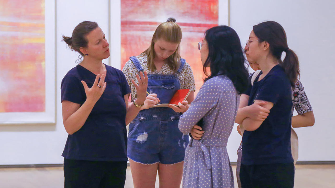 Students take notes on new exhibits at the Davis Art Museum for the fall 2018 season.