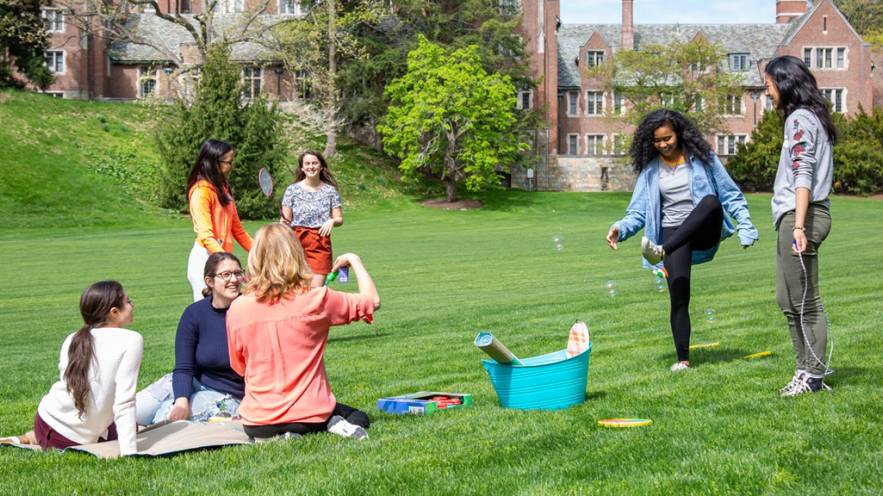 Students on Severance Green enjoy the outdoors in spring.