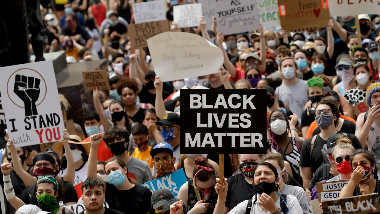 BLM protesters hold signs