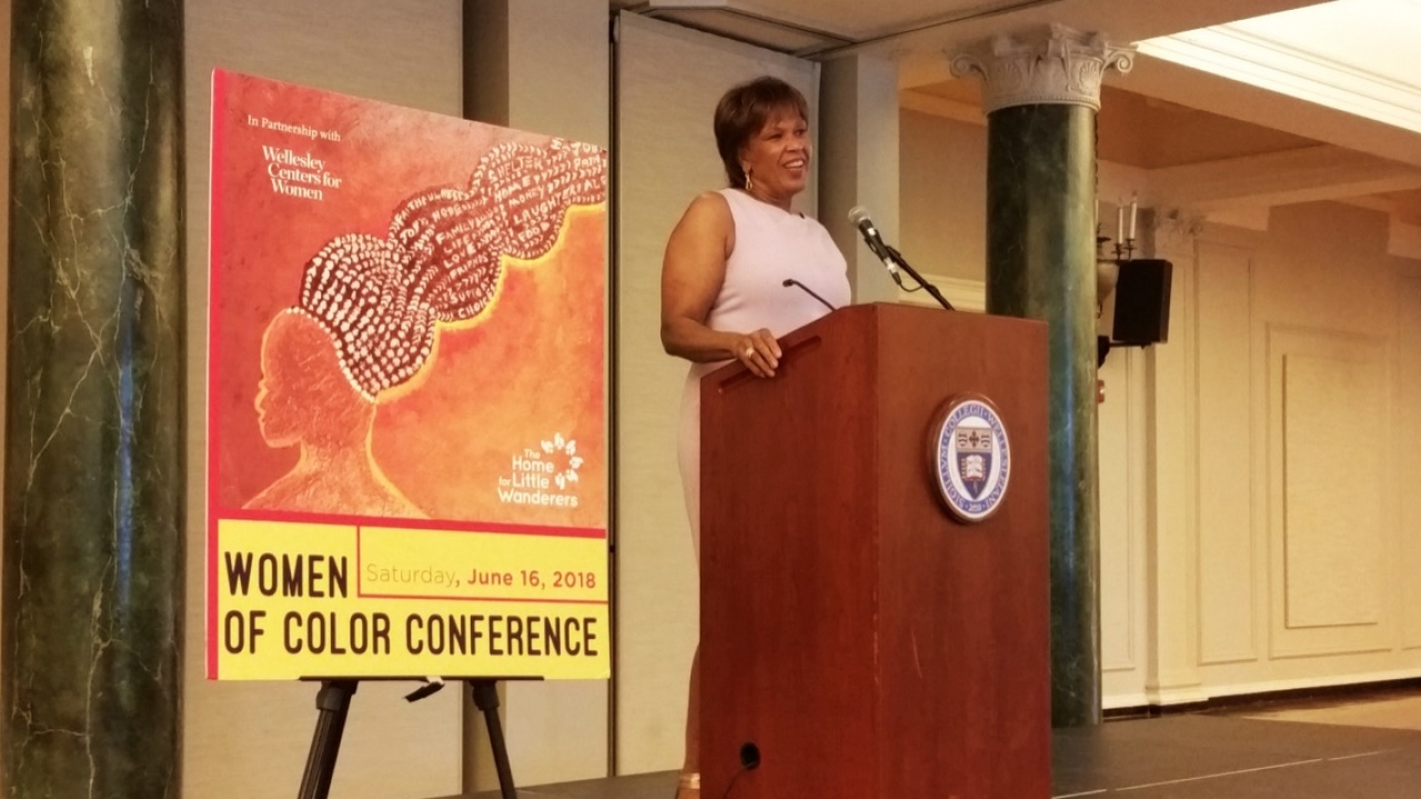 Liz Walker speaks at a podium as the keynote speaker at Wellesley's first ever Women of Color Conference.