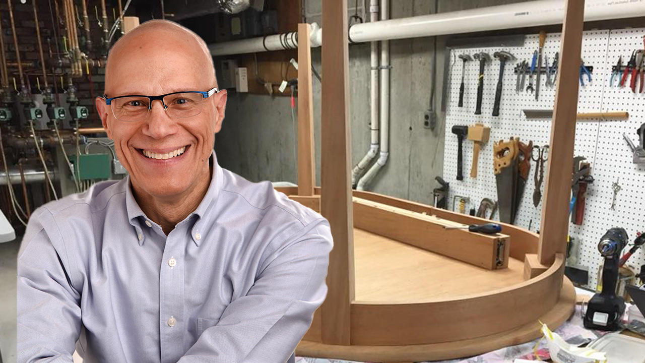 A composite photo with Professor Dan Sichel in the foreground and one of the tables he has made in the background.