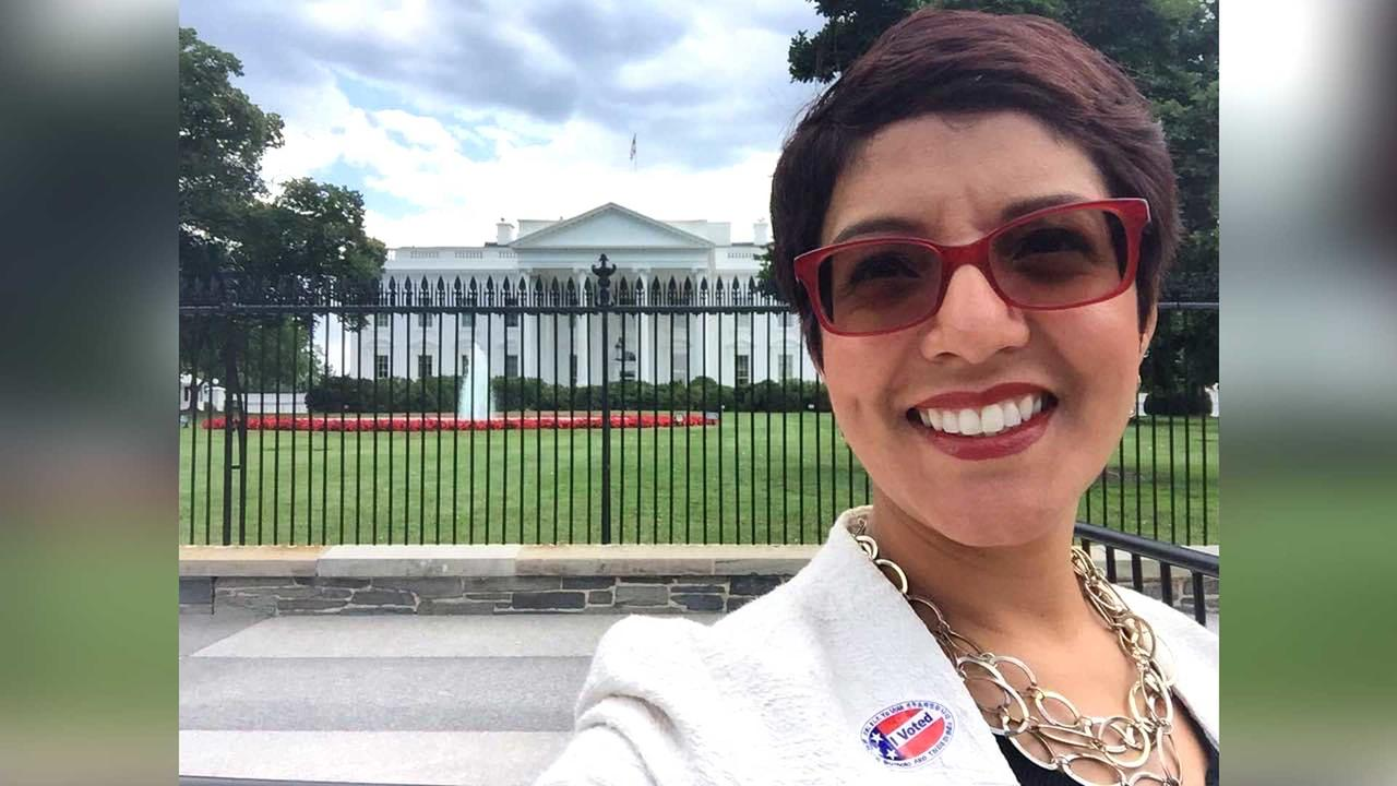 Dolores Arredondo '95 taking a selfie in front of the white house