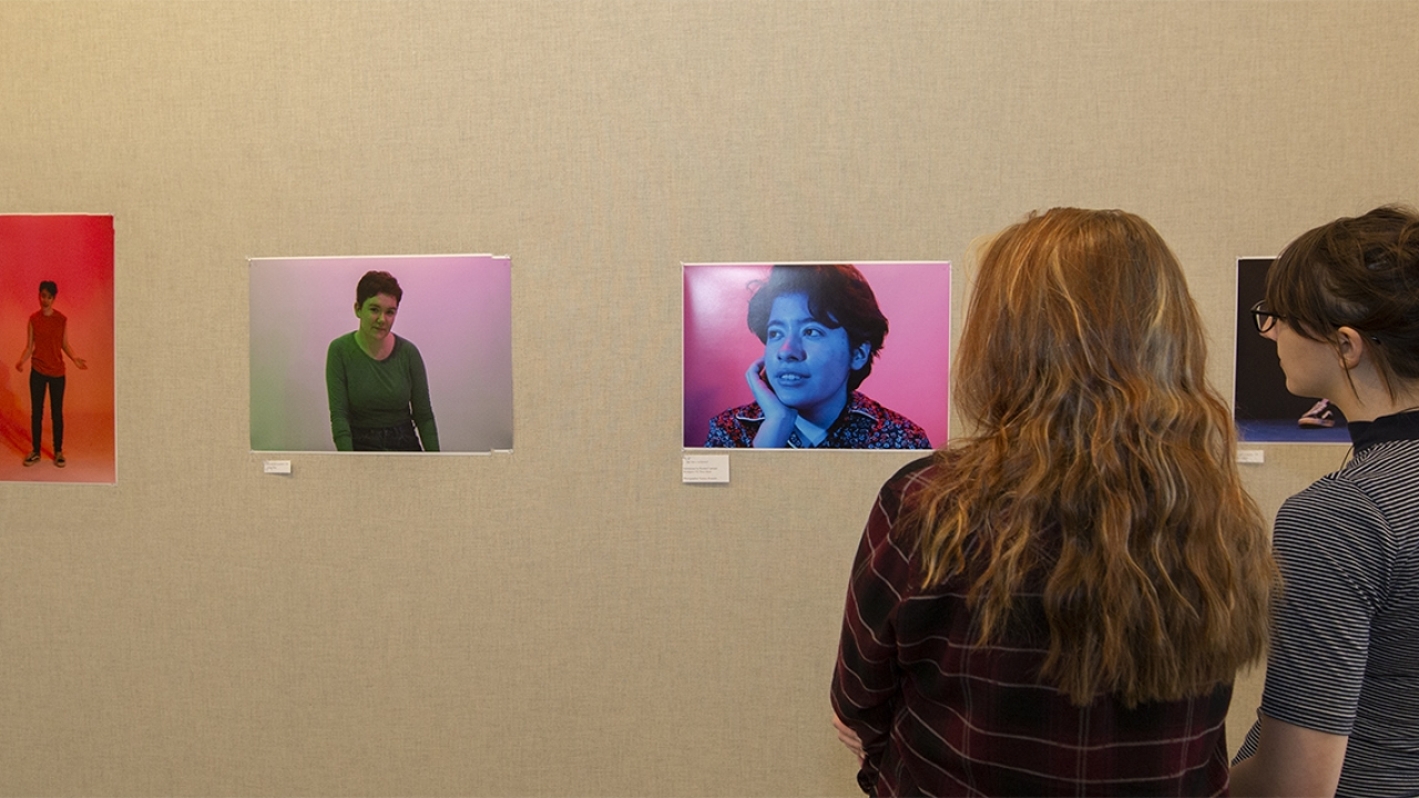 Two figures look at a photo exhibit
