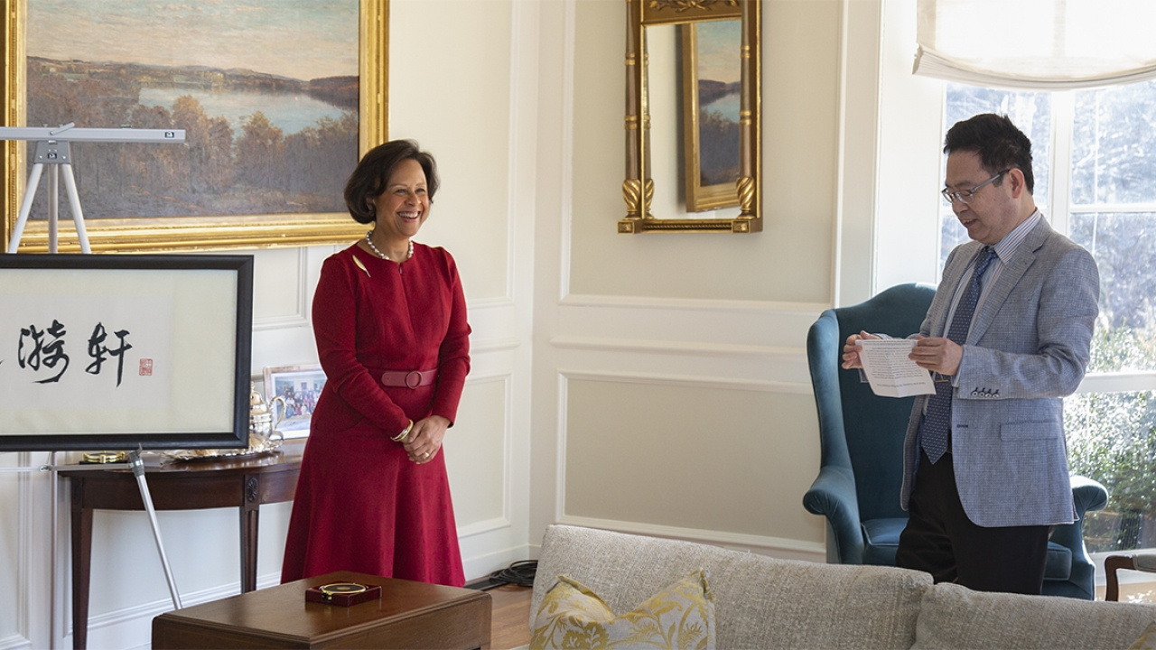 A professor presents a plaque to President Johnson