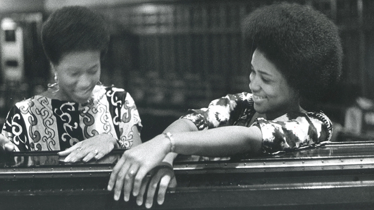 Two members of the Ethos Choir sit in the Houghton Chapel in 1973.