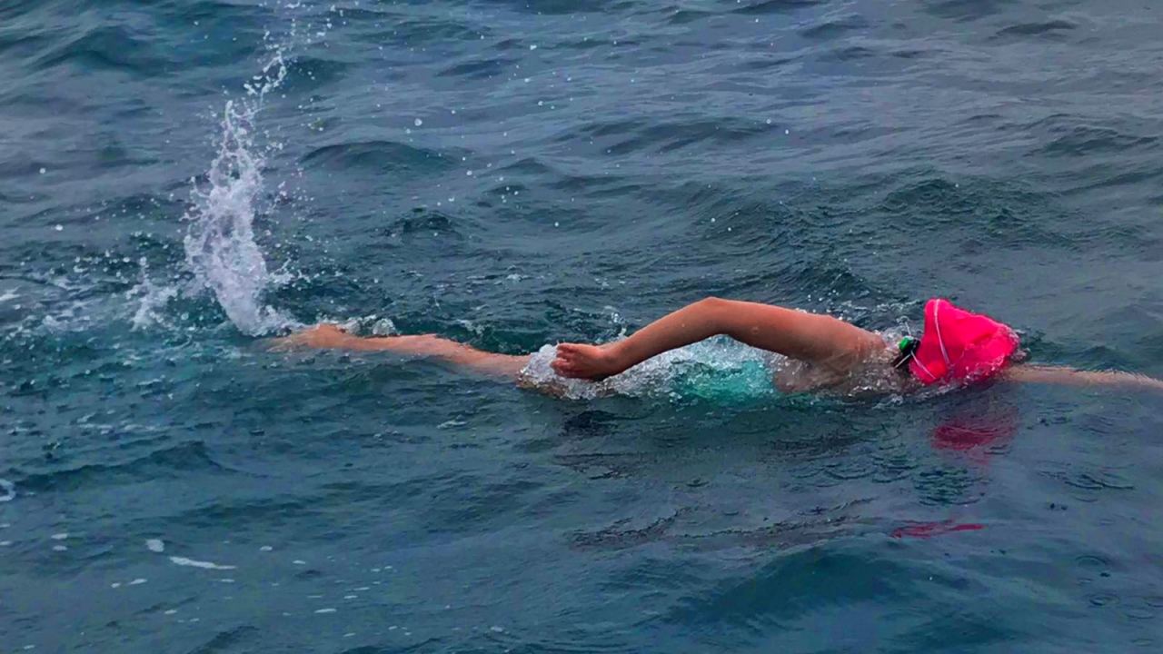 An alumna swims in the English Channel.