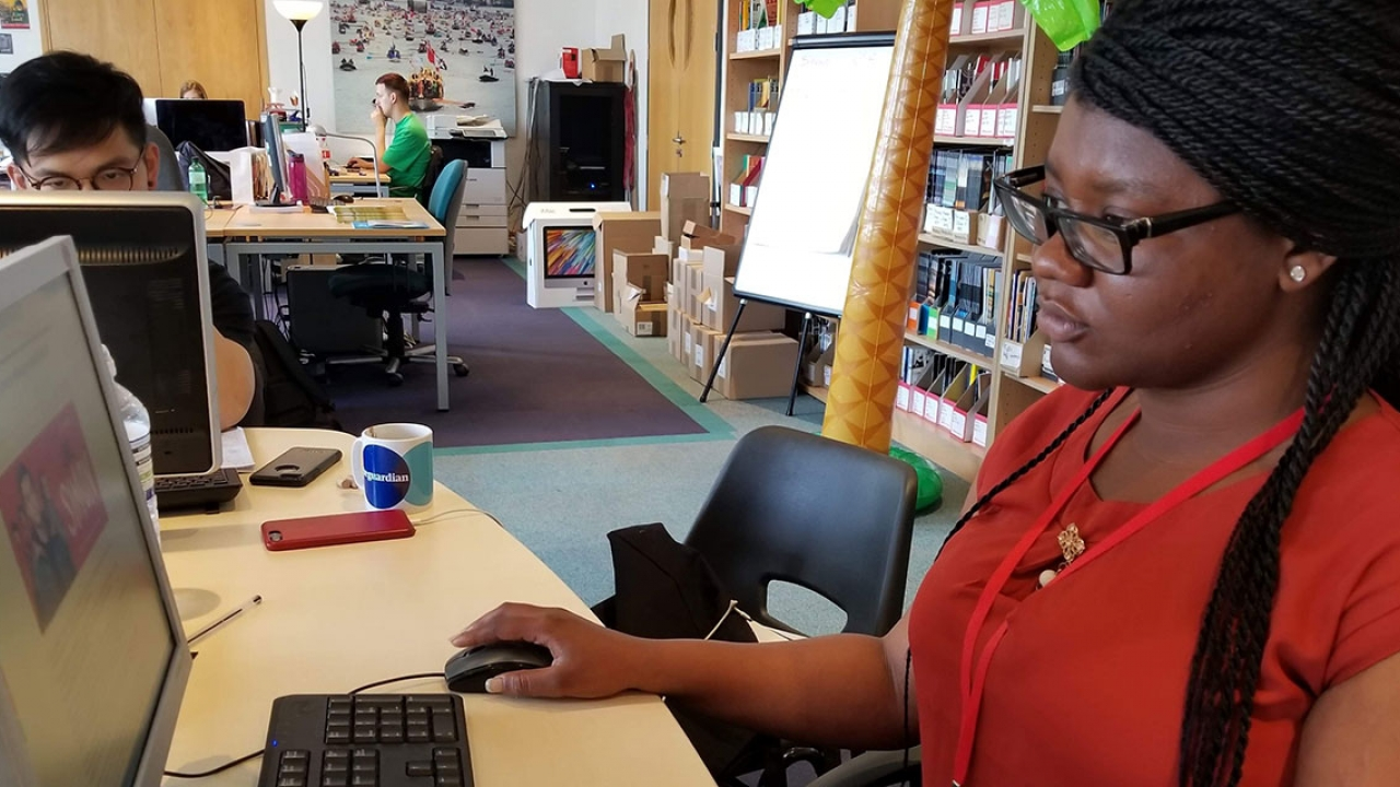 Nicole Ntim-Addae sits in front of a computer screen at her internship.