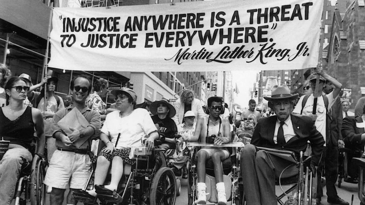 black and white photo of disability rights activists demonstrating