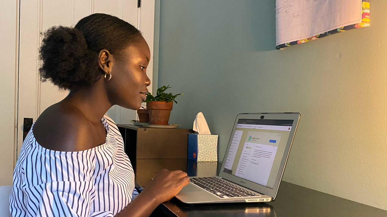 Adhel Geng '22 working on a laptop