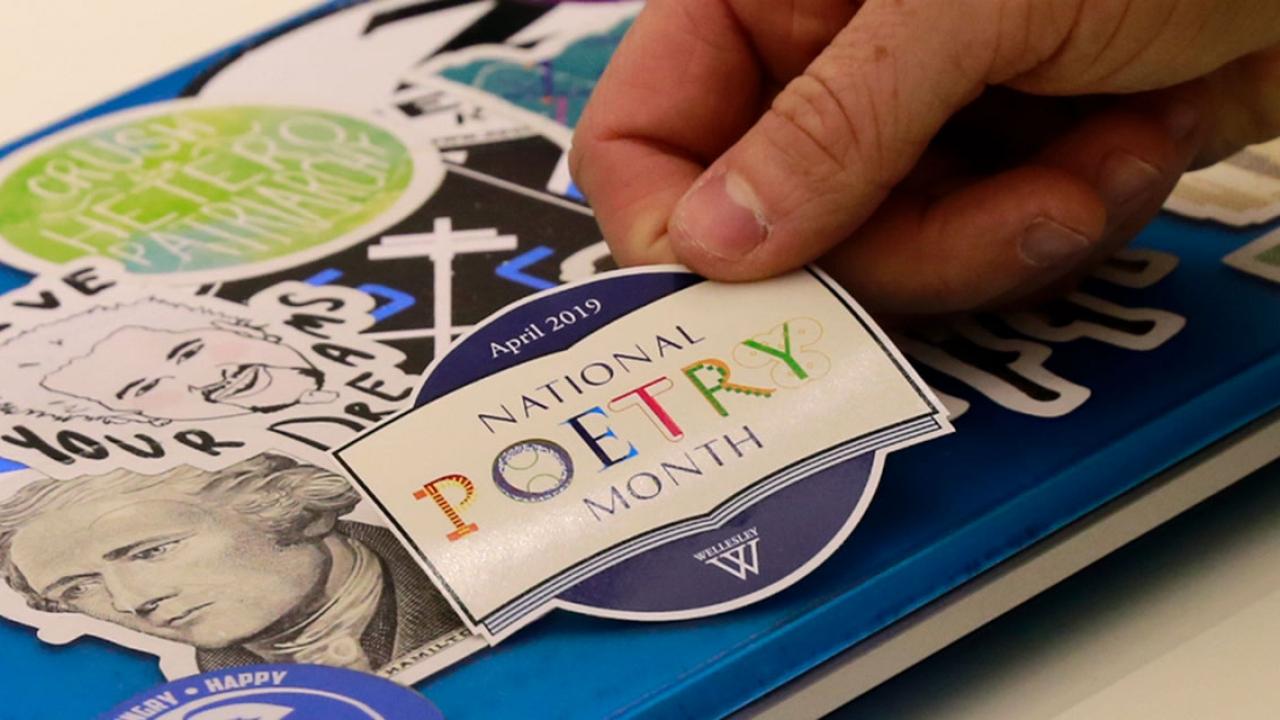 Poetry sticker on laptop