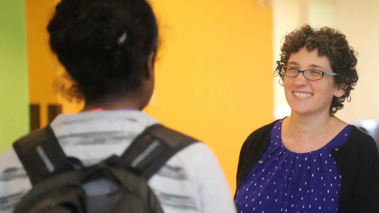 Rabbi Dena Bodian speaks to a student in Tischman Commons