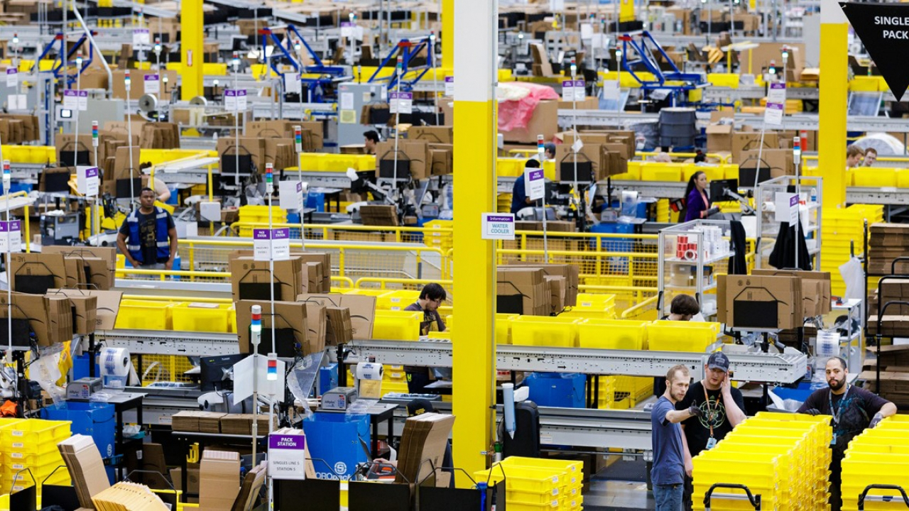workers in an Amazon shipping warehouse
