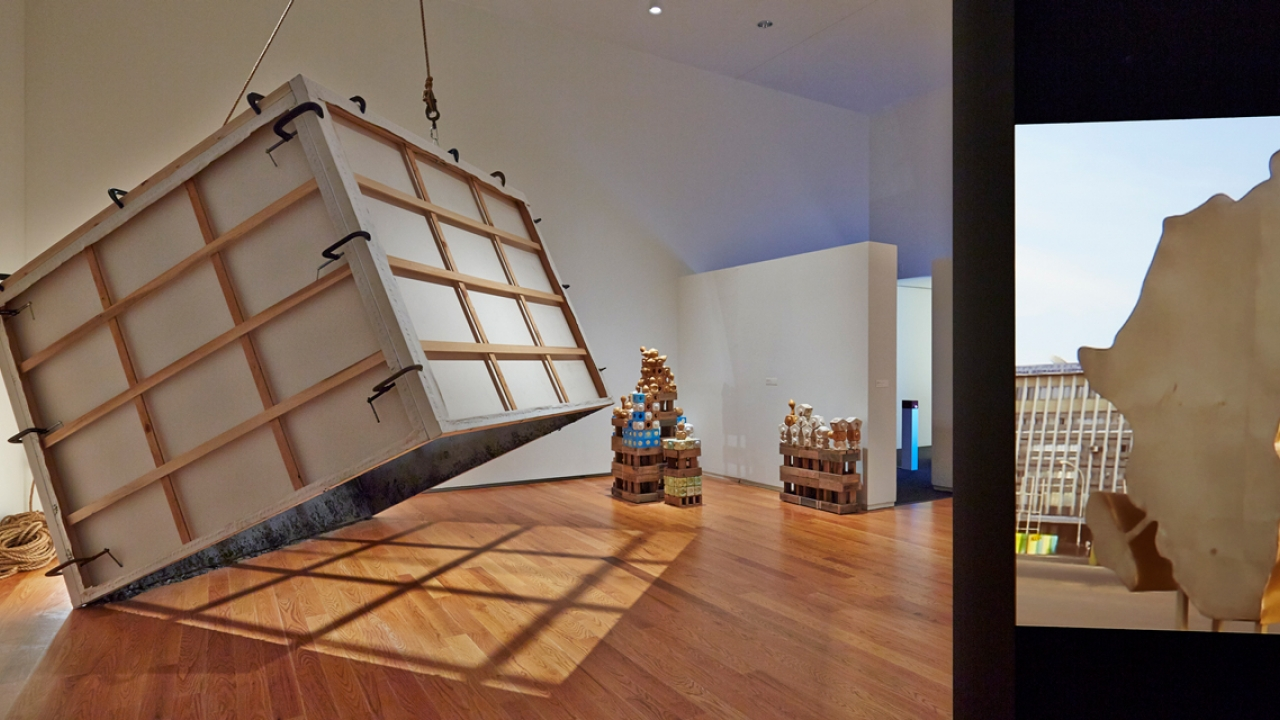A box tilts on its axis in an art space.