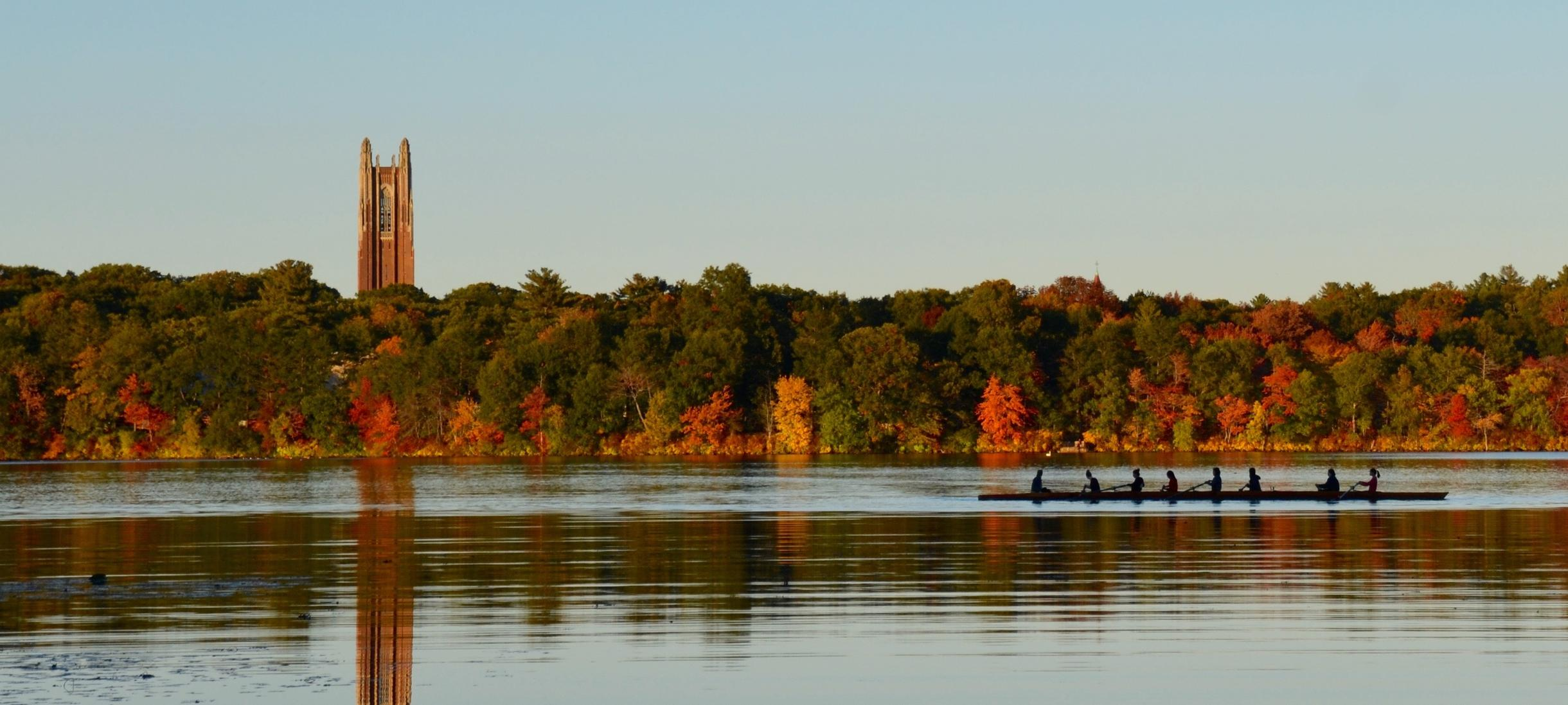 Picture of rowers, Wellesley tower, Lake Waban, autumn.