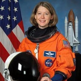 Pam Melroy with astronaut gear