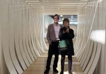 "Professor James Oles and former photography teacher Judy Black inside Helen Escobedo's ""White Corridor"""