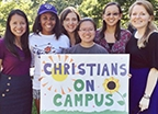 Christians on Campus members holding org sign