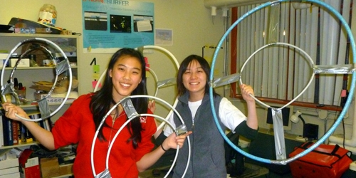 students show off their tangible construction desgins