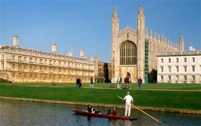 Man rowing in front of Oxbridge