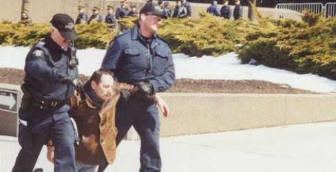 police hauling a man away