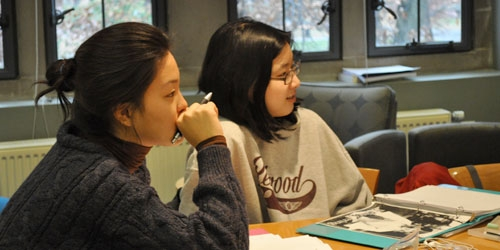 Students listening to discussions in the classroom