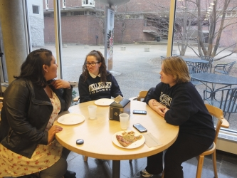 students sitting and talking around a table