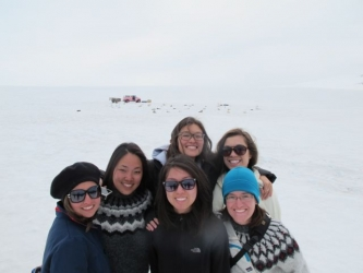 students in sweaters surrounded by snow